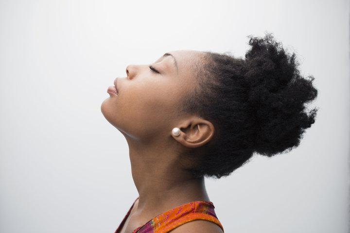 Profile portrait serene woman eyes closed head back